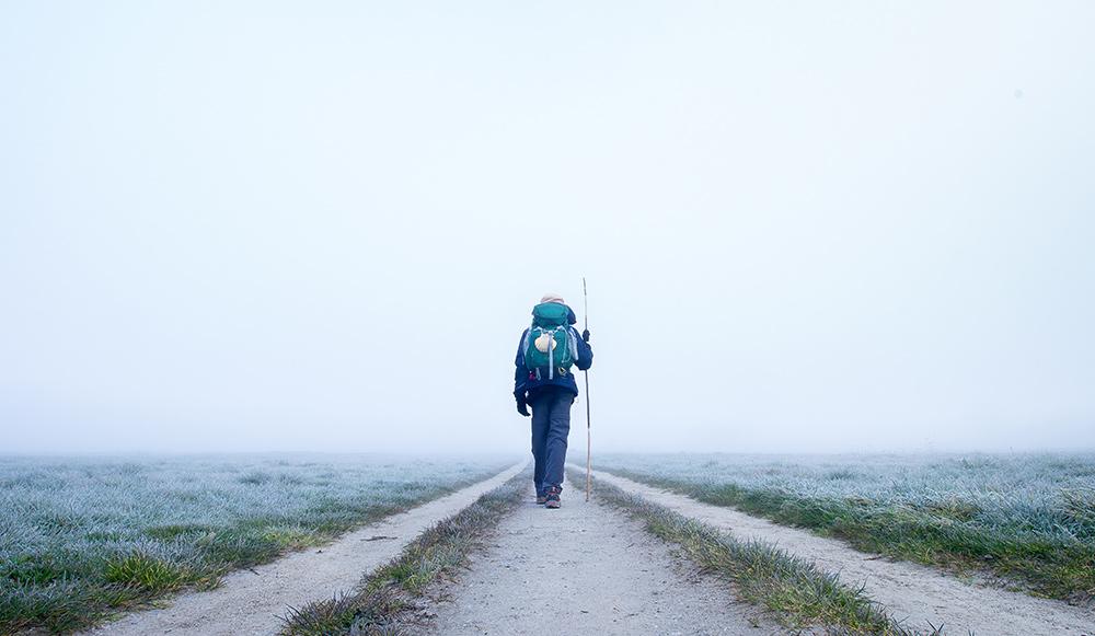 Hiker on an empty path